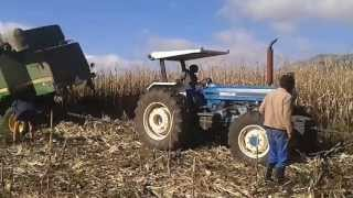 Ford tractors pull out John Deere combine