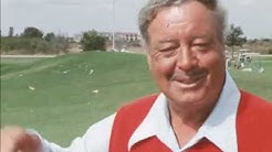 Jackie Gleason showing off his golden golf clubs and customised cart 1976 Florida