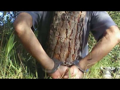handcuffed to a tree naked
