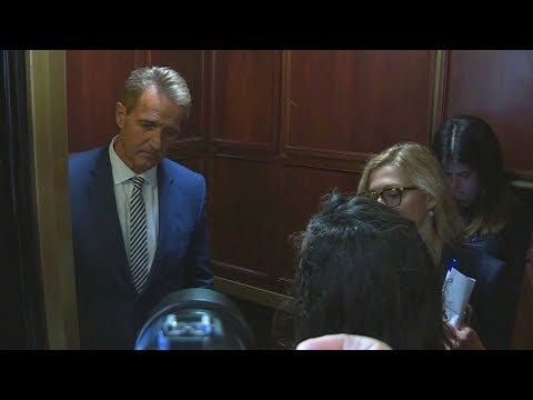 'Look at me': Emotional protesters confront Sen. Jeff Flake