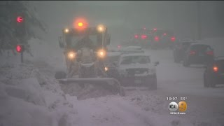 The plows are out in force around Big Bear, but they're having trou...