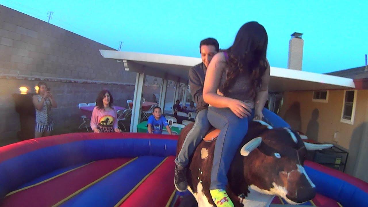 boy and girl riding mechanical bull