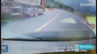 Man risks life to jump on out-of-control truck in Wenzhou, China