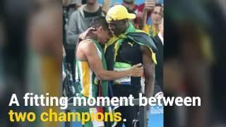 Usain Bolt congratulates Wayde van Niekerk