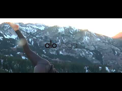 Little Abbie doing Yoga in the Wasatch by  Brighton Resort on a Peak.