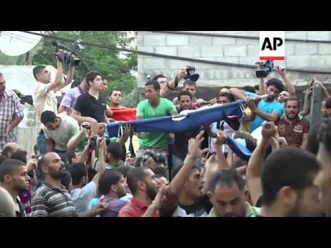 Hundreds gather for funerals of three children killed by Israeli airstrike
