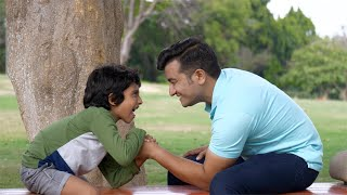 Excited Indian boy defeated his father in a friendly arm-wrestling game - playtime concept