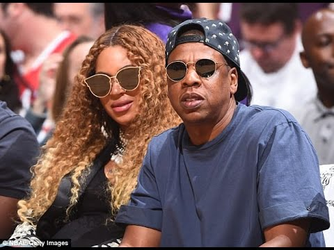 Pregnant Beyonce and Jay Z share tender moment courtside at basketball game as they await birth