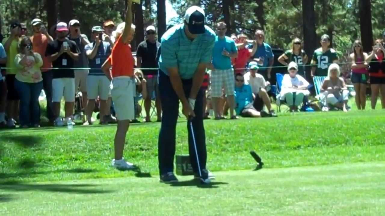 Aaron Rodgers teeing off  at 2013 American Century Lake Tahoe golf event