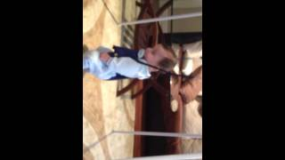 Funny baby jumping on jolly jumper 6 mouths old