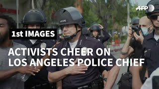 US: Activists cheer on Los Angeles police chief during George Floyd protest | AFP