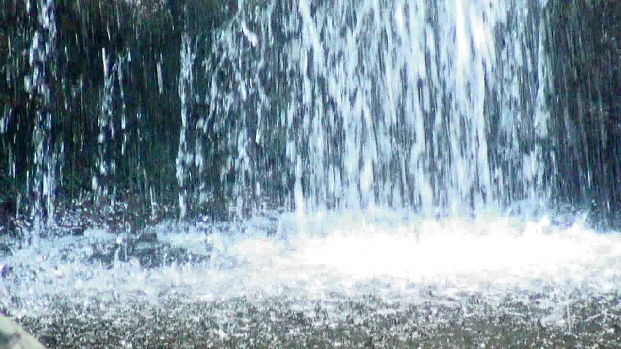 Water From A Waterfall Splashing Into A Pond Youtube