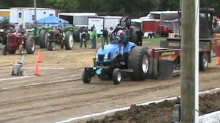 Brad on his NH 6080 pulling tractor