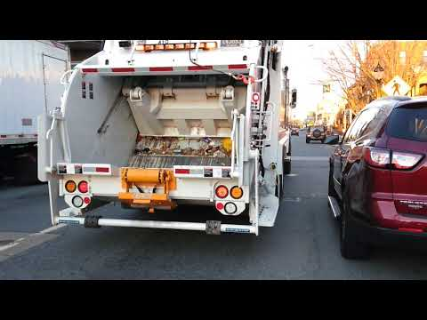 Brand new city of Newark Delaware garbage truck in action