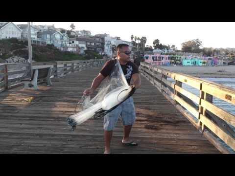 Cast net fishing capitola pier youtube for Pier fishing net