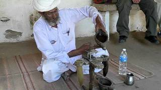Making  some opium water to the god Shiva, Bishnol, 28-2-2011.AVI