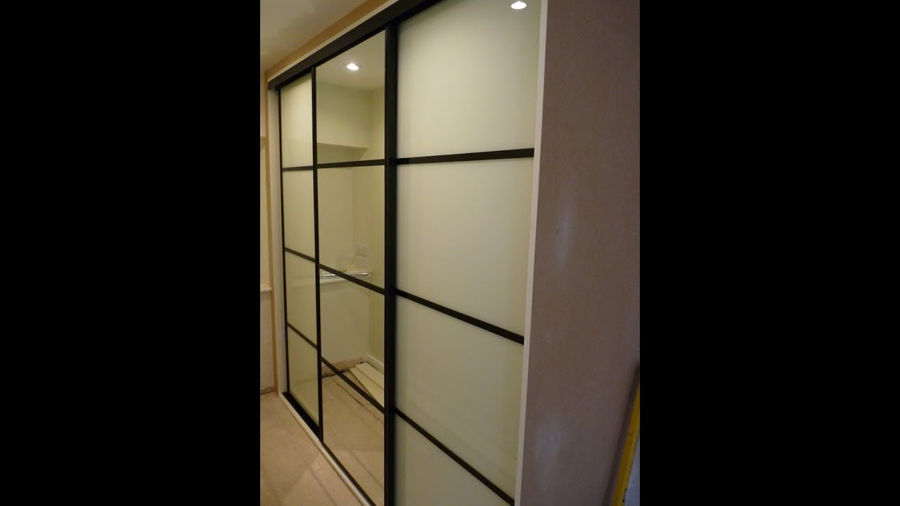 Custom built sliding door wardrobes soft white mirror for Built in sliding doors