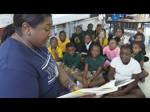 College Students Volunteer at an Elementary School