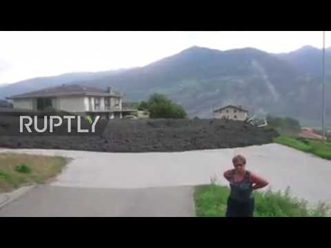 Huge MUD FLOW ploughs through Swiss town of Chamoson