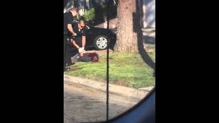 LAPD police handcuff man after shooting him in back of head