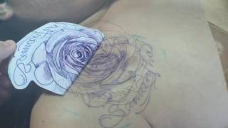 Red rose tattoo by Pocho