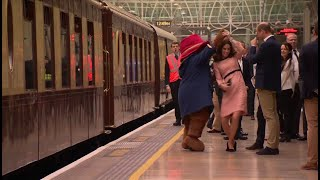 Princess Kate dances with Paddington Bear at London train station