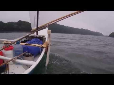 Canoe sailing Helford
