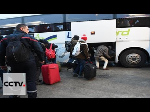 Migrants from the Calais camp arrive at various reception centers