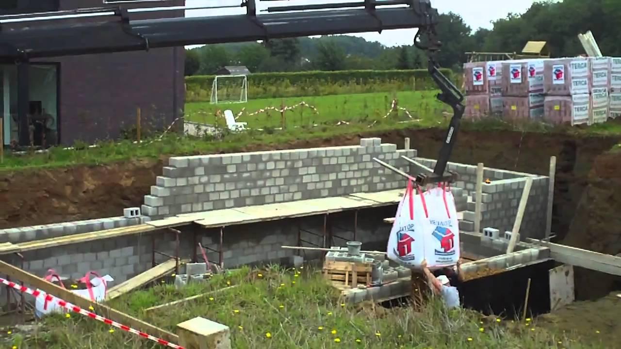 Plaatsing grind voor drainage rond kelder door Heumatop Bouwmaterialen ...