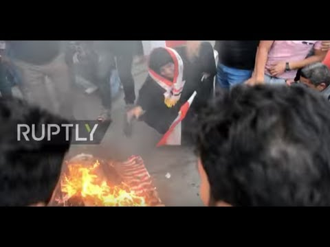 Iraq: Stars-and-stripes burn as Baghdadis condemn strikes in Syria