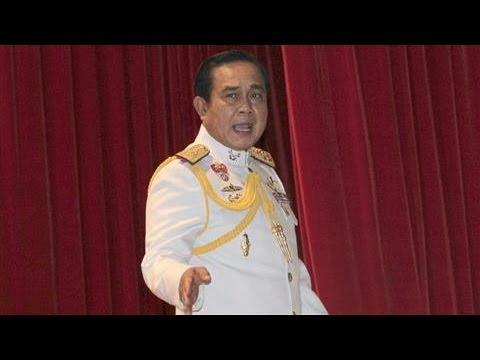 Thailand's junta eases politics ban in step toward polls