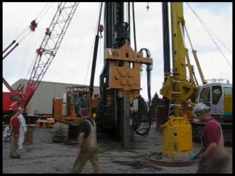 A Model 85 Piledriving Rig With An APE 170VM Vibratory Hammer Driving An H-Pile