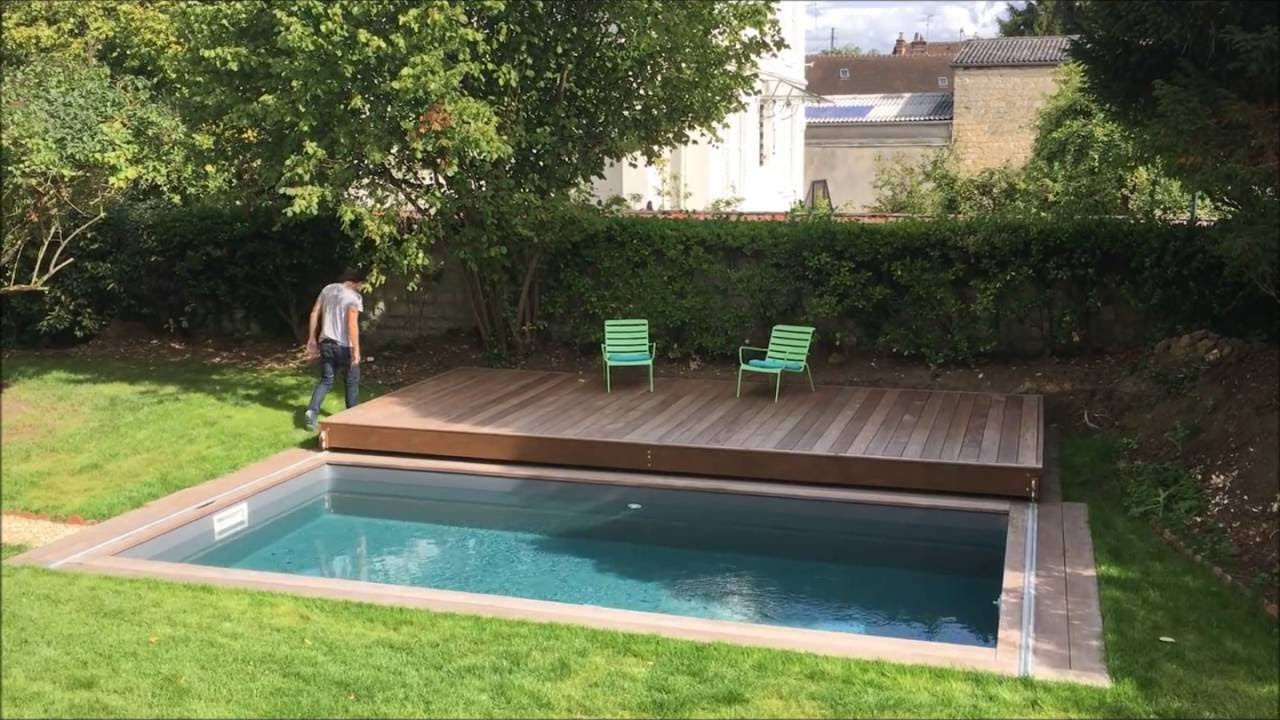 Terrasse mobile de piscine un rolling deck de plus de for Terrasse coulissante piscine