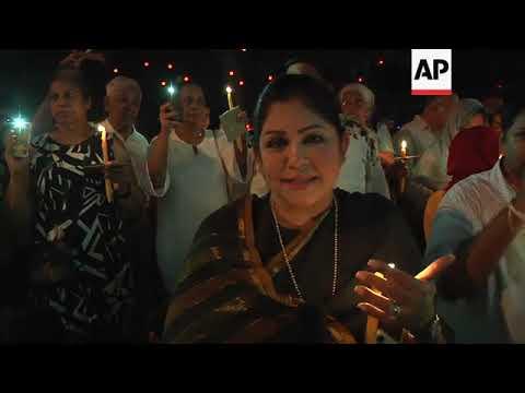 Protesters hold candlelit vigil after Sri Lanka's president dissolves parliament