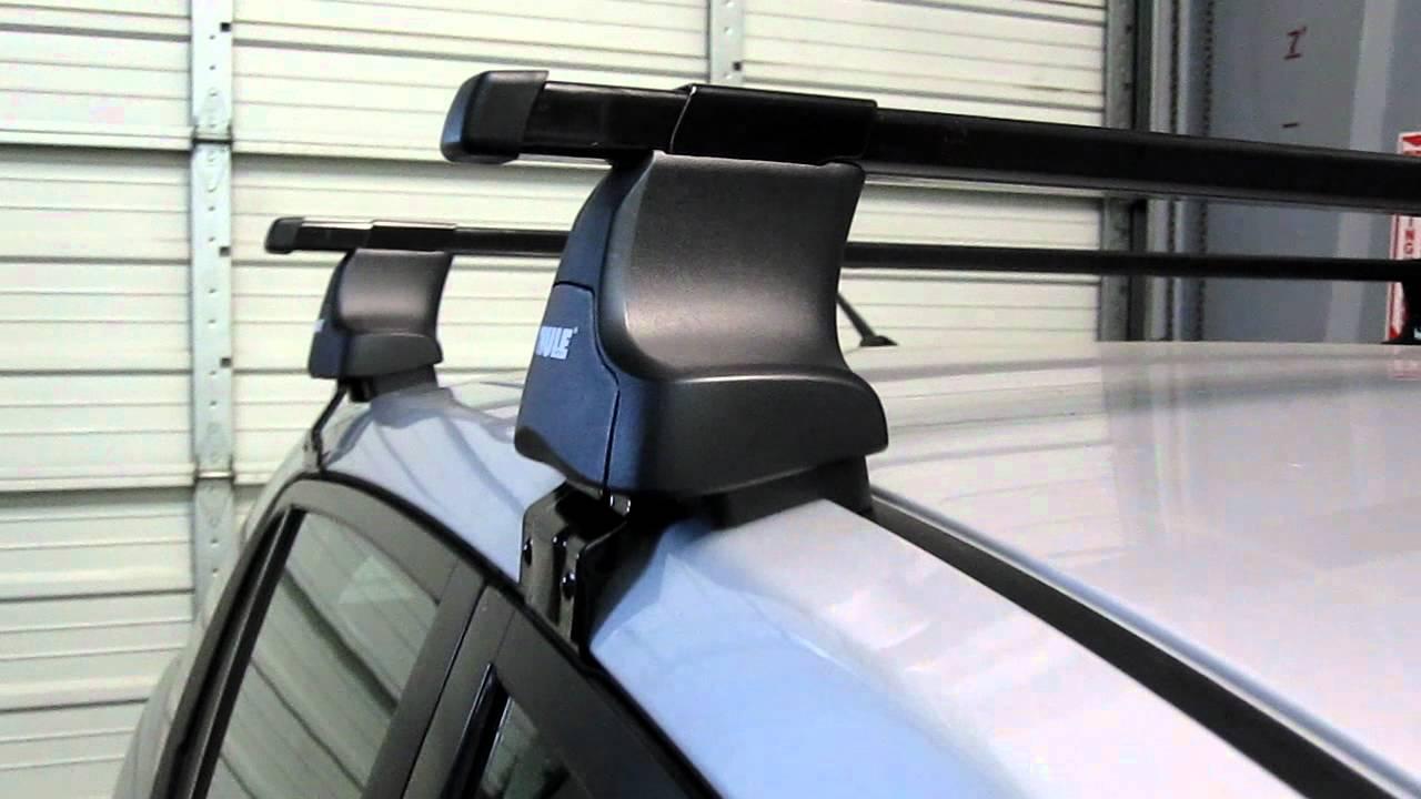Nissan Versa 4 Door Sedan With Thule 480 Traverse Base