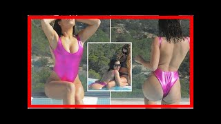 Katie Salmon splashes around in a sparkly pink swimming costume on sun-soaked holiday in Spain with