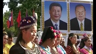During visit, President Xi inks deals to assist development in Laos