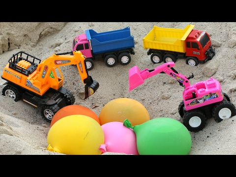 รถดั้ม บรรทุกลูกโปร่งมาเทลงบ่อโดน รถแม็กโคร เจาะจนแตก | excavator dump truck and balloon.