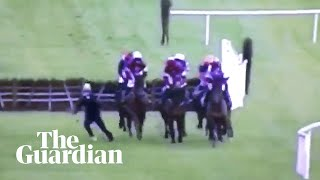 Jockey narrowly avoids getting trampled after jogging on to track