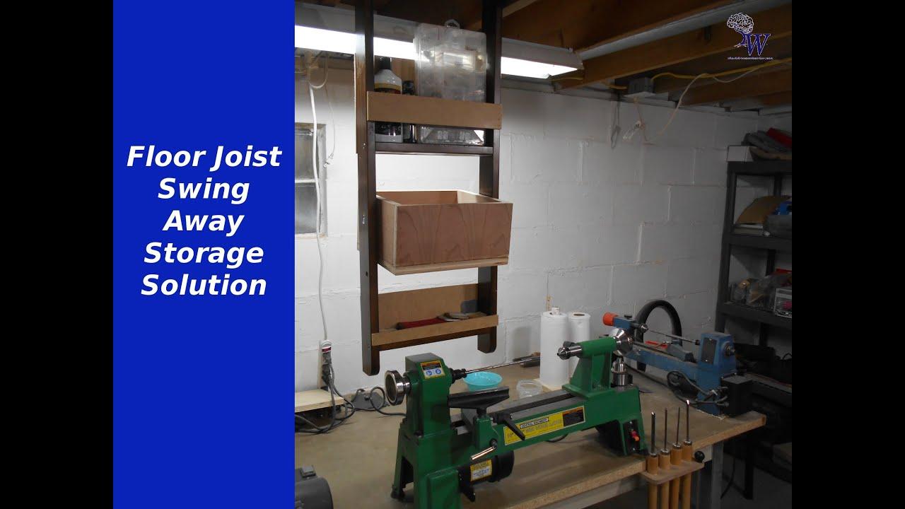 Floor joist swing away storage