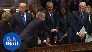 George W. Bush gives Michelle Obama candy at father's funeral