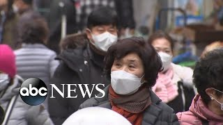 Concerns grow over virus spreading as new hot zone identified in South Korea