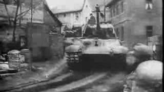 King Tiger II passing through Tondorf - Battle of the Bulge