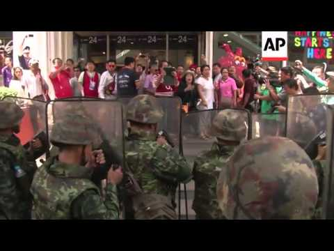Angry scenes as soldiers scuffle with anti-coup protesters
