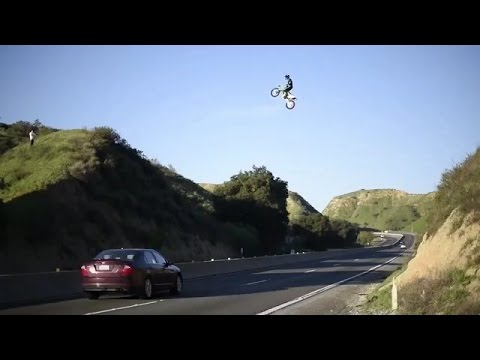 Kyle Katsandris jumps motorbike across freeway!