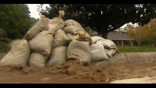 Rain, flooding and mudslides threaten California neighborhoods