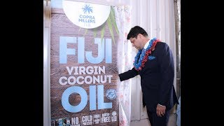 Fijian Minister for Economy commissions virgin coconut oil production.