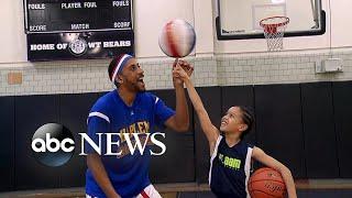 Harlem Globetrotter surprises 9-year-old basketball star: