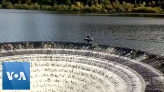 Fishermen Float Close to 'Plughole' on English Reservoir