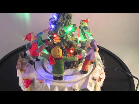Dancing children Christmas village scene musical animated Christmas scene